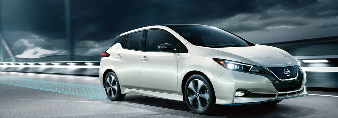 2021 Nissan Leaf driving down the road