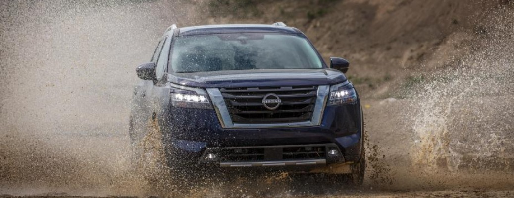 2022 Nissan Pathfinder blue front view in mud
