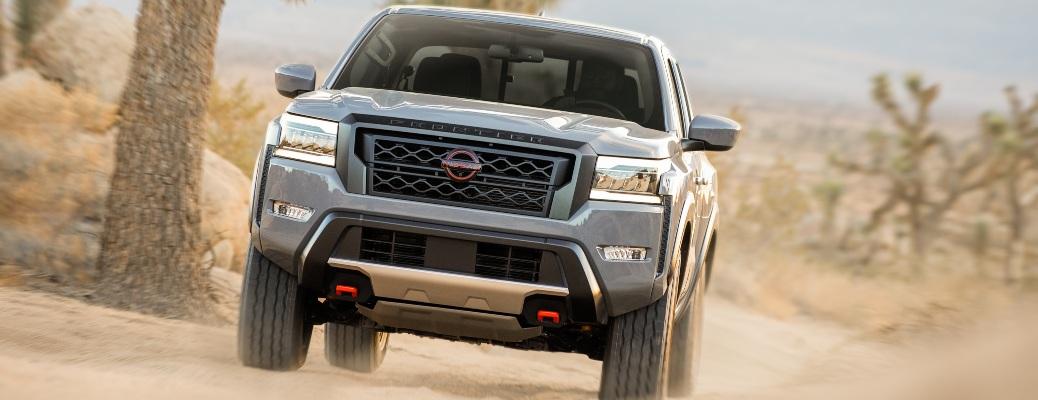2022 Nissan Frontier gray front view in desert