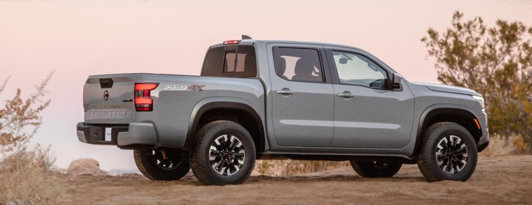 2022 Nissan Frontier gray side view in desert
