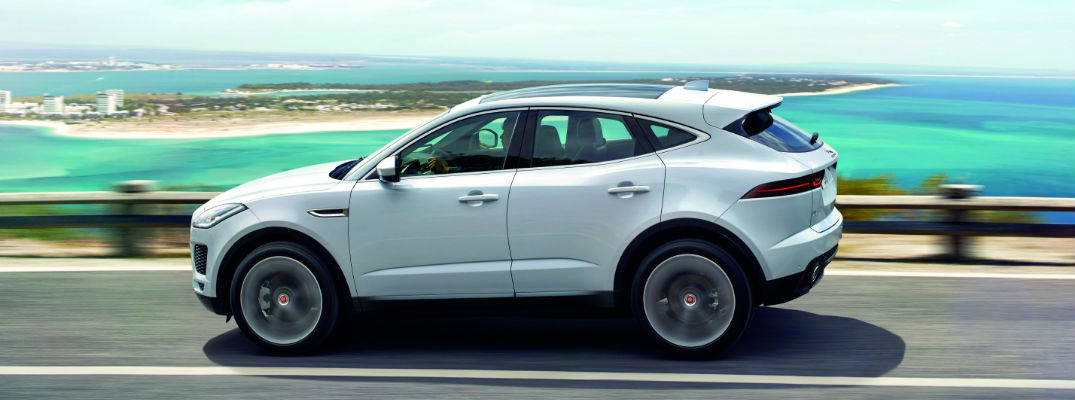 White 2018 Jaguar E-PACE Side Exterior on Coastal Highway with Ocean in Background