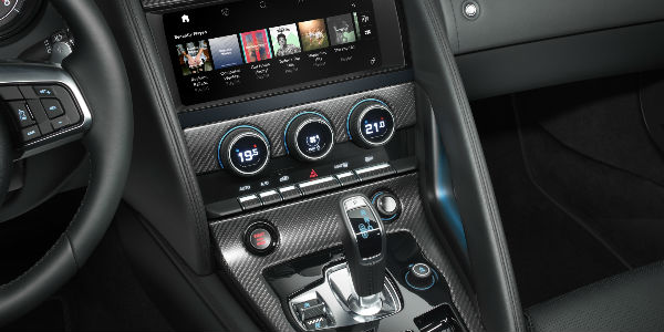 Close Up of 2019 Jaguar F-TYPE Touchscreen, Shifter and Center Console with Carbon Fiber Trim
