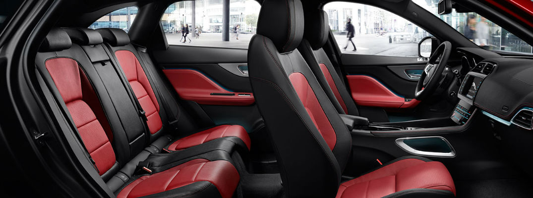 Cutaway View of Red and Black 2018 Jaguar F-PACE Front and Rear Seats
