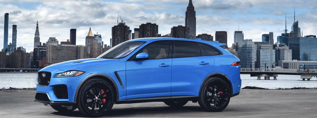 Blue 2019 Jaguar F-PACE SVR Side Exterior with City in the Background