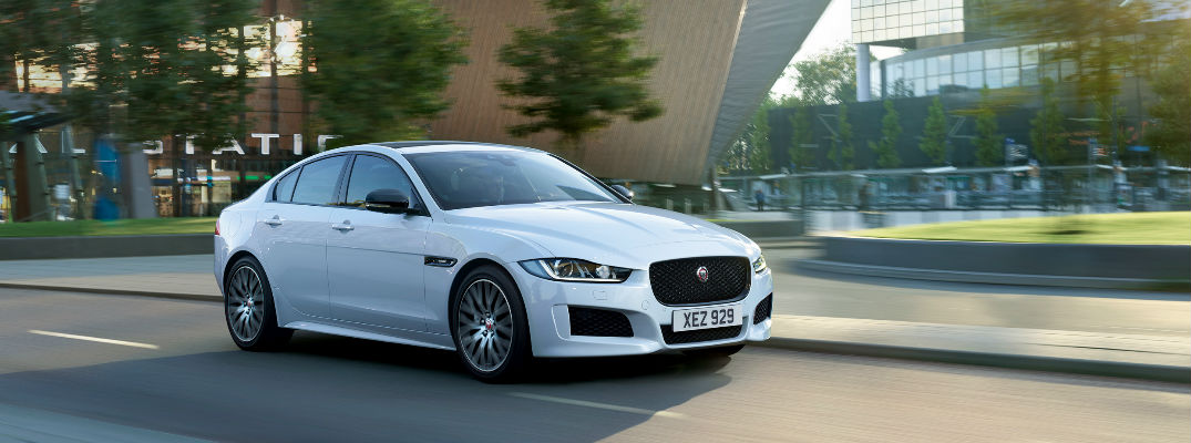 White 2019 Jaguar XE Landmark Edition Driving on a City Street