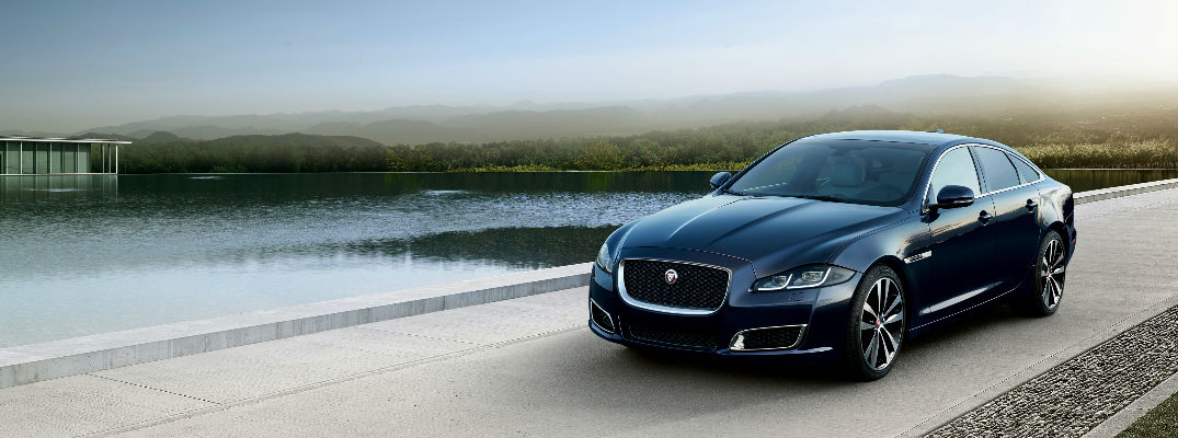 Black 2019 Jaguar XJ50 Limited Edition Driving Next to Water