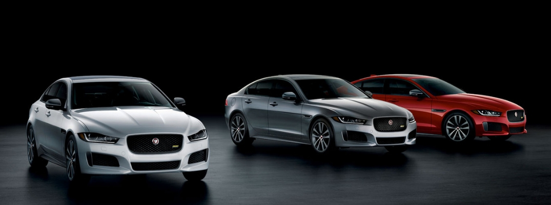 Silver, Gray and Red 2019 Jaguar XE Sport Models on a Dark Background