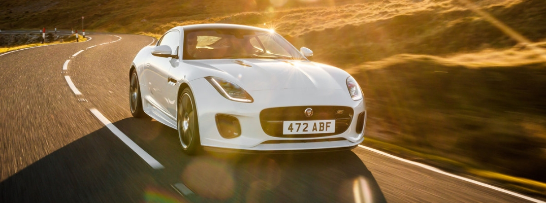 White and Black 2020 Jaguar F-TYPE Checkered Flag Limited Edition on a Highway at Sunset