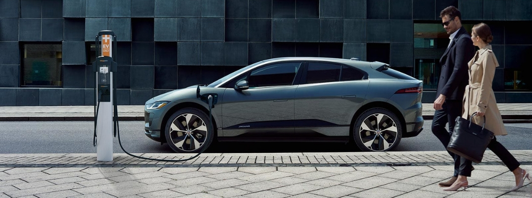 Silver 2019 Jaguar I-PACE Plugged In on City Street