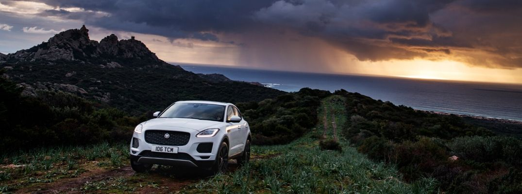 White 2020 Jaguar E-PACE on Mountain Road at Sunset