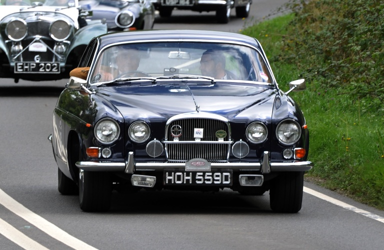 Jaguar MK X going down the street