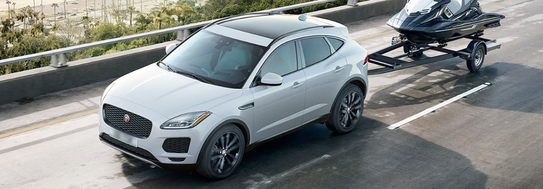 2020 Jaguar E-PACE pulling a jet ski down the road
