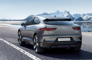 2020 Jaguar I-PACE driving towards the snow covered mountains
