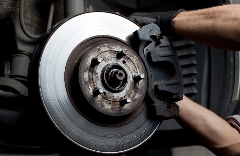 Mechanic working on a brake pad