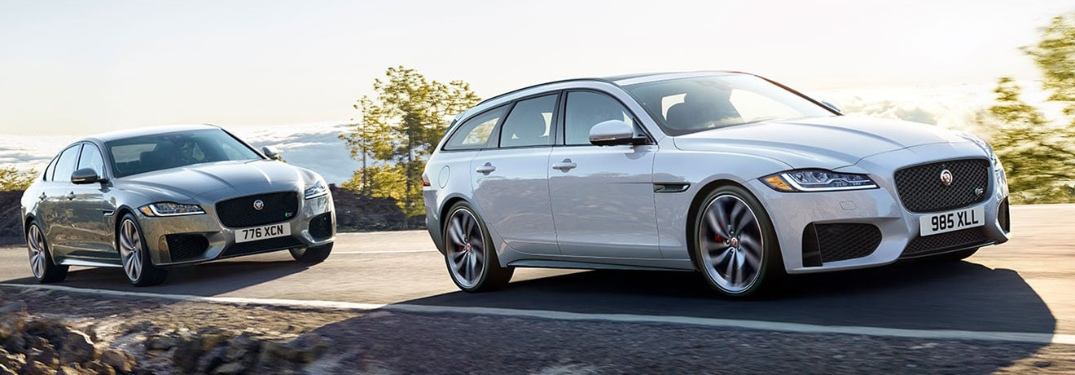 Two 2020 Jaguar XF sedans going down the road