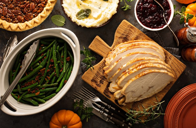Various Thanksgiving Day foods on a table