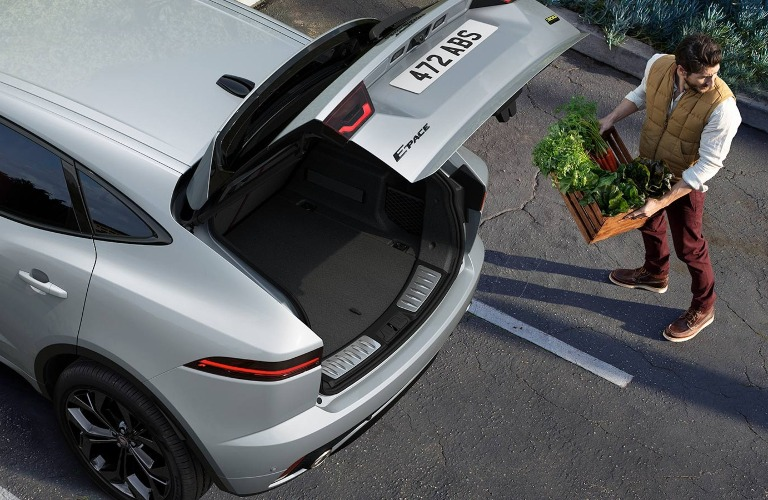 Man loading up the back end of the 2021 Jaguar E-PACE