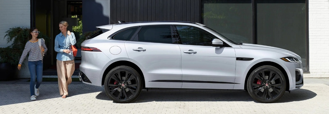 2021 Jaguar F-PACE profile view and two people