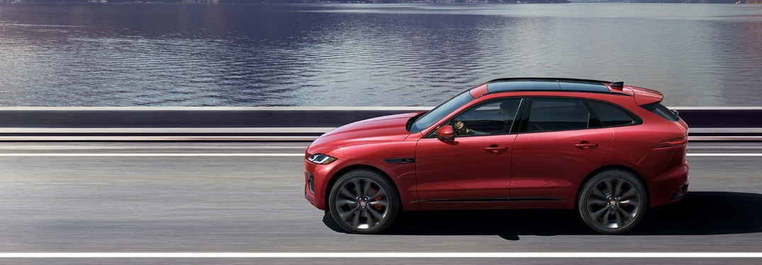 2021 Jaguar F-PACE driving next to water