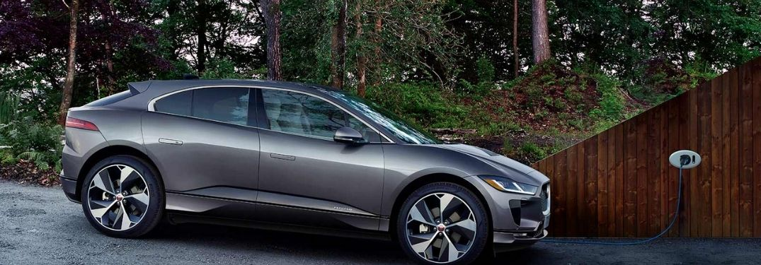 2021 Jaguar I-PACE charging in a tree covered road