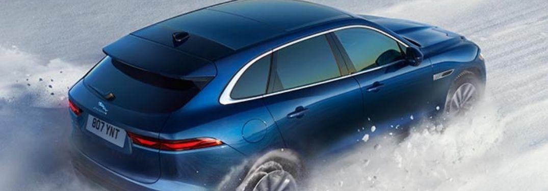 2021 Jaguar F-PACE driving through snow