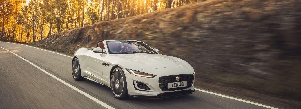 The European Model of 2022 Jaguar F type cruising through the road
