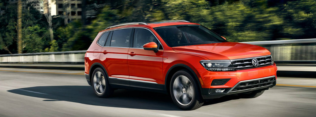 2018 Volkswagen Tiguan driving through suburban neighborhood