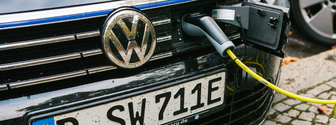 Volkswagen vehicle being charged electrically through grille cap