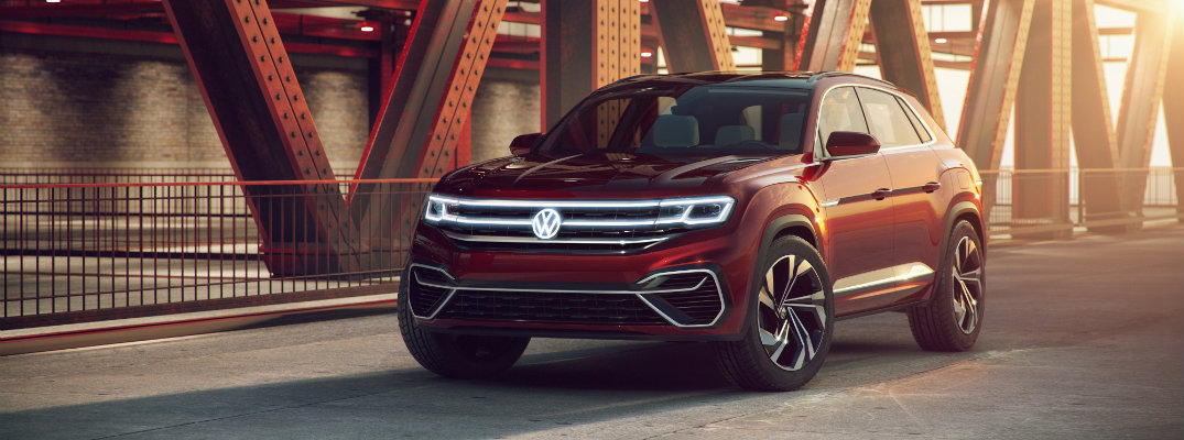 vw atlas cross sport suv concept hybrid front exterior shot parked on a sunrise bridge with bright shadows
