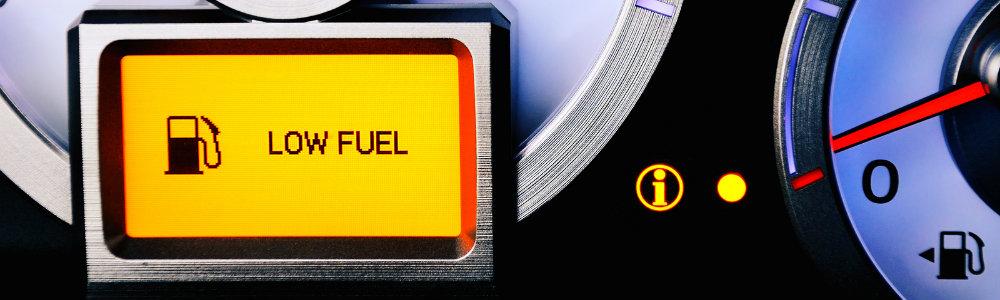 Low Fuel light shining on modern dashboard