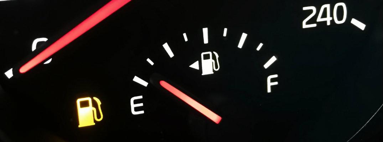 Low Fuel Light illuminated next to gas gauge