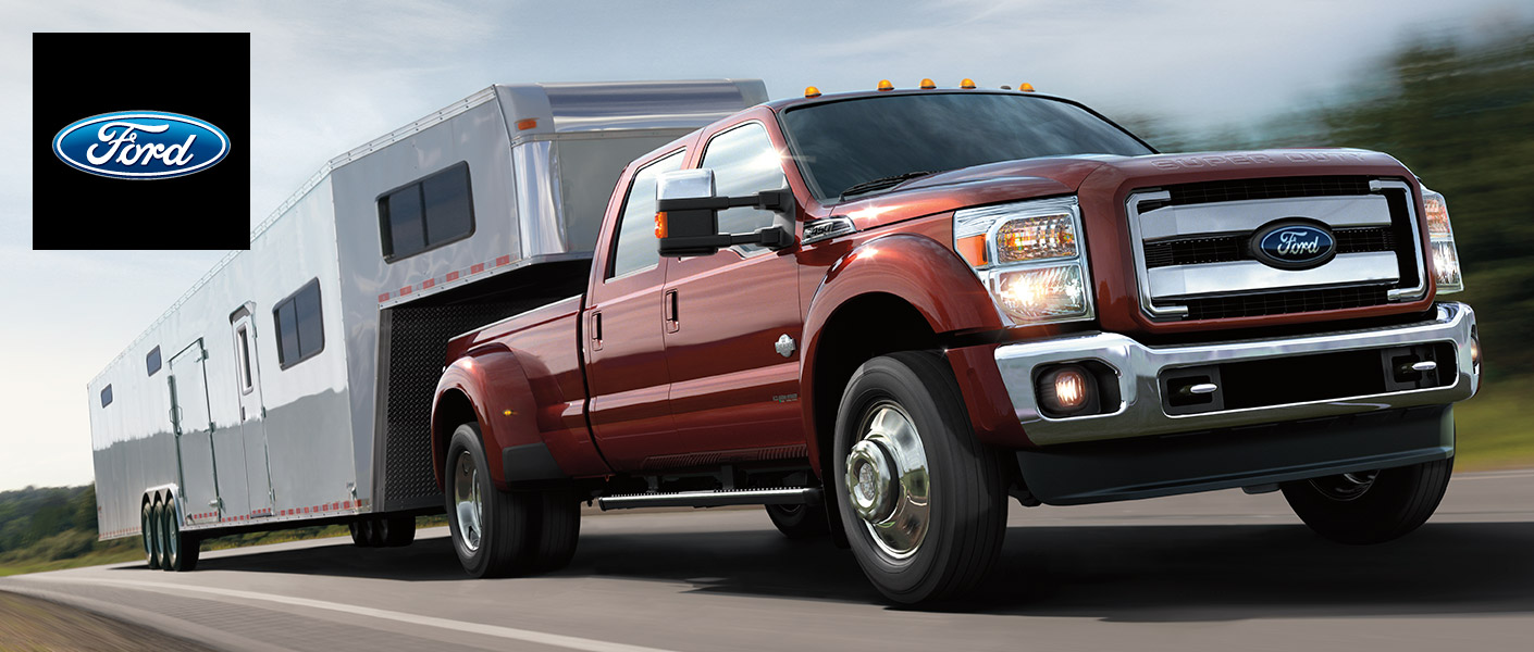 red 2015 ford f-350 towing a trailer