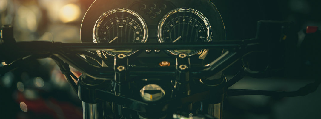 Stylized image of motorcycle gauges and handles on black background