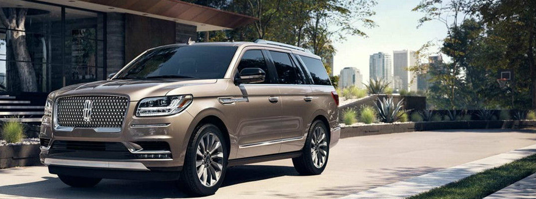 2018 Lincoln Navigator parked in front of city skyline