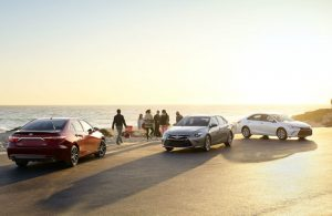 Three 2017 Toyota Camry models parked on beachfront