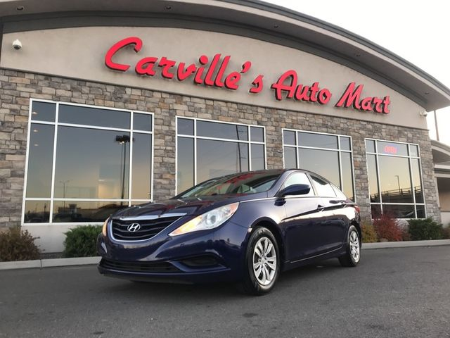 hyundai sonata parked in front of carville dealership