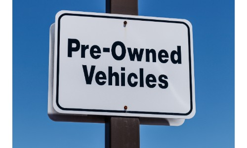 Sign saying pre-owned vehicles