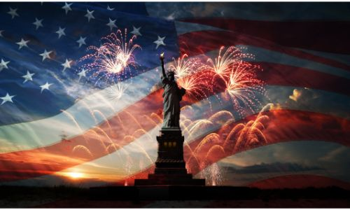 Statue of Liberty with flag and fireworks