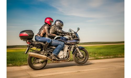 Couple cruising on a motorcycle