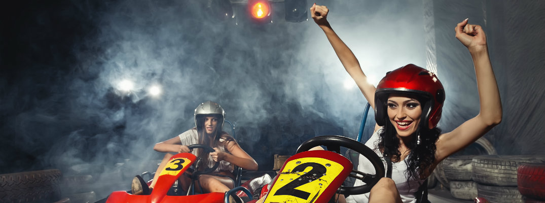 Woman driving a go-kart in a smoky room