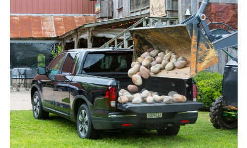 2019 Honda Ridgeline being filled with rocks