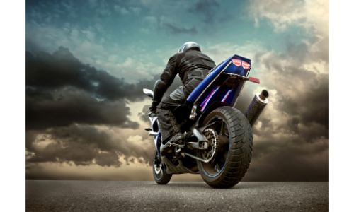Low angle shot of a man on a motorcycle