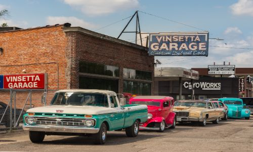 Vintage cars parked by the sidewalk