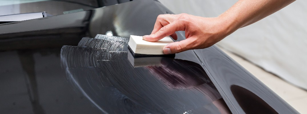 Polish being applied to the hood of a car