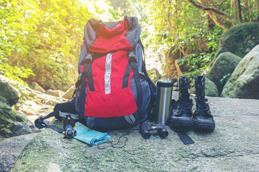 Backpack and gear on rock
