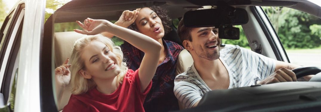 Friends in car singing to music