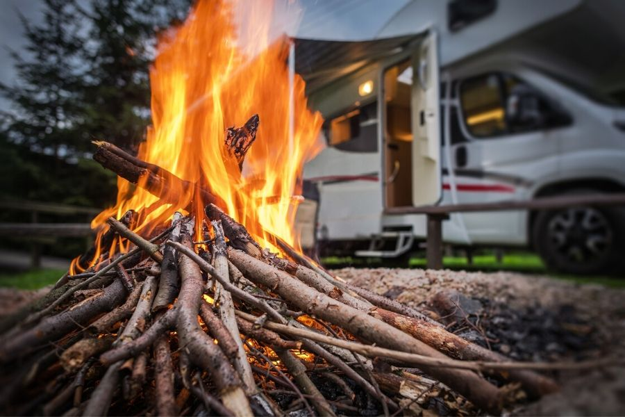 Sticks on fire in front of RV