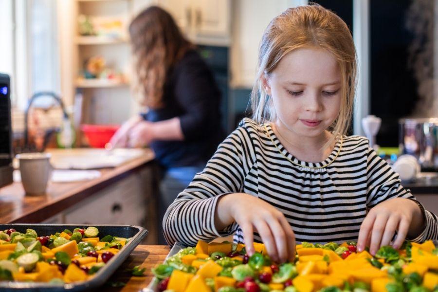 Girl preparing fruit on a pan