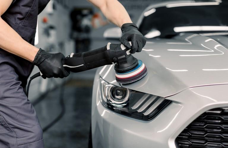 Mechanic waxing car