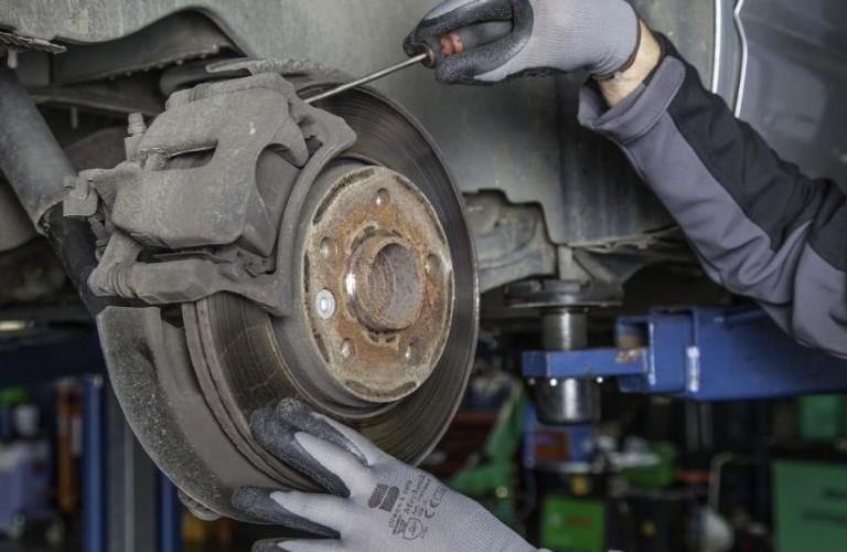 Mechanic working on brake
